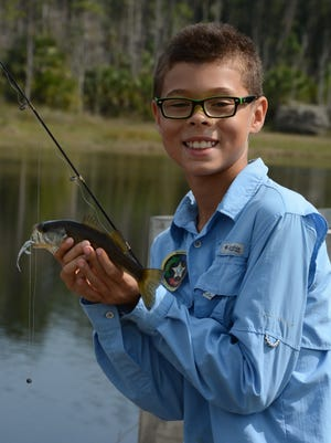 """Devin Varona, 9, caught at least three fish. The Collier County Junior Deputies League hosted the tenth annual """"Kids Love Fishing"""" event Saturday morning Feb. 18, around Camp Discovery at the Florida Sports Park."""