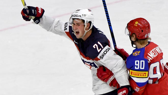 Red Wings forward Dylan Larkin, left, celebrates after scoring for the U.S. next to Russia's  Vladislav Namestnikov during a group A match between Russia and USA at the 2017 Hockey World Championships in the Lanxess Arena in Cologne, Germany on May 16, 2017.
