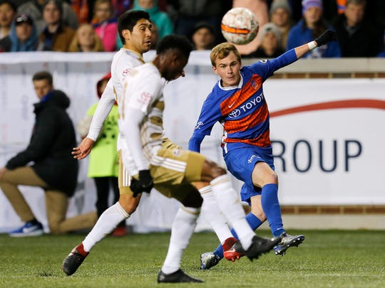 FC Cincinnati Jimmy McLaughlin (20) shoots in the second half of the USL soccer match between FC Cincinnati and Louisville City FC at Nippert Stadium in Cincinnati on Saturday, April 7, 2018. FC Cincinnati fell to Louisville, 1-0.