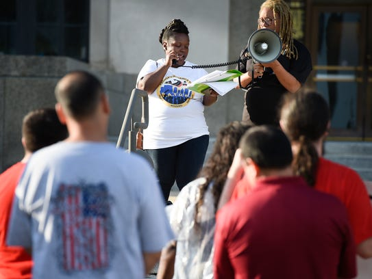 Kennetha Patterson speaks during a rally for equitable