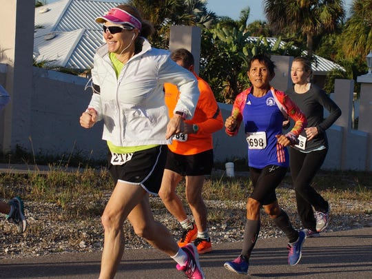 Grace Plager, in the white windbreaker, is an Ironman finisher and is training to compete at the Ironman 70.3 in Queensland, Australia, in September, 2016. Maria Lamb of Marco Island, in purple shirt, completed in the the Boston Marathon in April and the New York City Marathon in November.