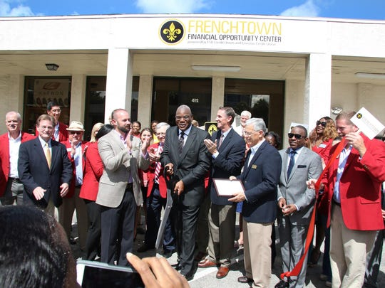 Monday morning, Chuck Adcock III, executive vice president at FSU Credit Union; Darryl Worrell, president/CEO at Envision Credit Union; and the Rev. R.B. Holmes, pastor at Bethel Missionary Baptist Church, join representatives and ambassadors from the Greater Tallahassee Chamber of Commerce to dedicate and officially open the Frenchtown Financial Opportunity Center.