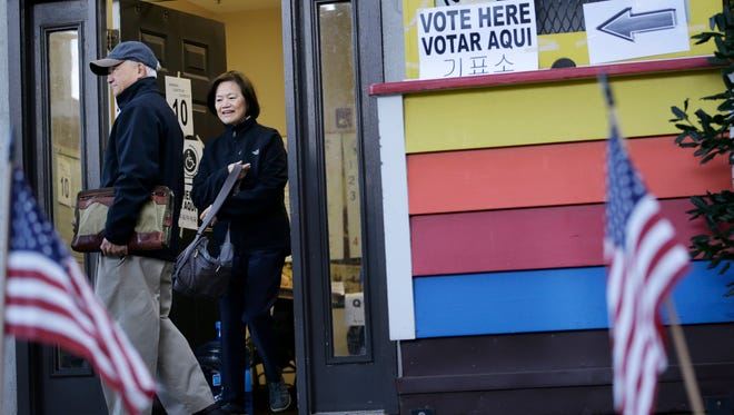 New Jersey voters exit a polling site Tuesday at the Fort Lee Museum in Fort Lee.