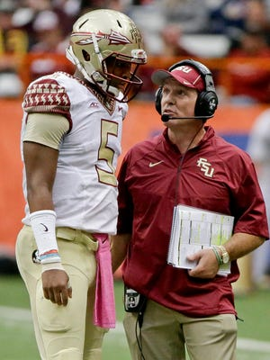 "Jameis Winston talks to Florida State head coach Jimbo Fisher earlier this month. Herschel Walker said that Fisher is ""enabling"" Winston."