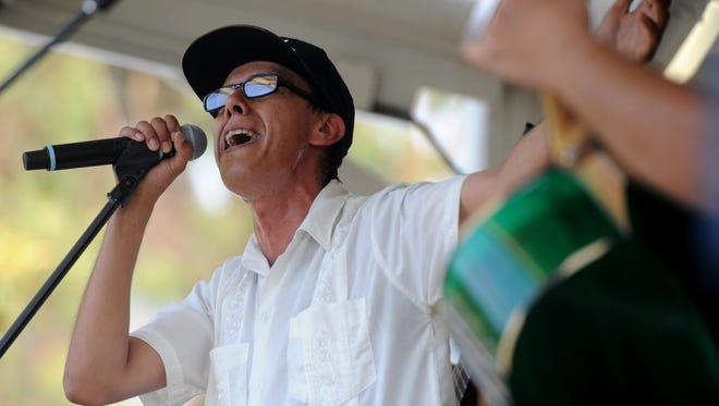 Gustavo Alcoser, lead vocalist of Jarabe Mexicano, performs at Mission Park as part of the Ventura Music Festival, which runs through Sunday. This concert was free.