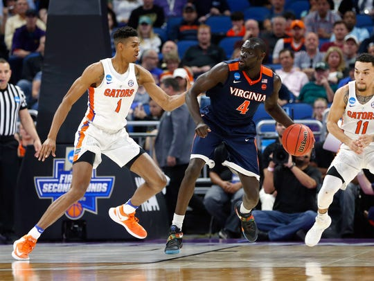 Virginia guard Marial Shayok is transferring to Iowa