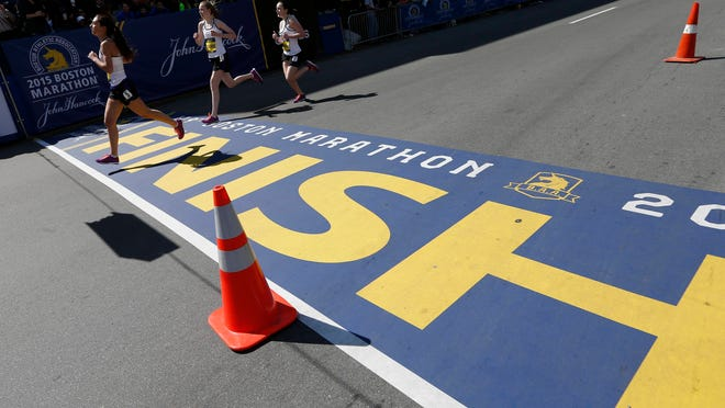 Runners in the girls scholastic mile compete as part of Boston Marathon weekend activities in Boston, Saturday, April 18, 2015.