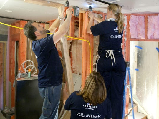 (Left to right) Vincent D'Ugo of East Meadow, New York, Julie Kieffer of Bernardsville and Tiffany Walsh of Toms River, volunteers with the St. Bernard Project, help rebuild the Sea Bright home of Julie Kellner, which was damaged during superstorm Sandy.