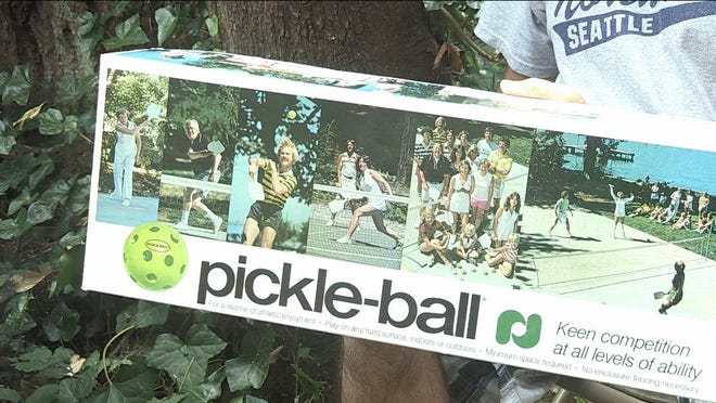 Kate McCallum, daughter of one of the three co-inventors of pickleball, is one of the players pictured on the original Pickle-Ball kits sold in the late 1970s. She can be seen hitting a ball in the fouth image from the left as well as in the group photo next to it of some of the original pickleball players. She now lives part of the year in Ormond Beach and recently became a member of the new Pictona at Holly Hill pickleball club.