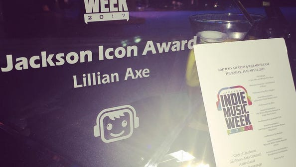 An ward handed to the band Lillian Axe at the Jackson Icon Awards Thursday at Duling Hall.