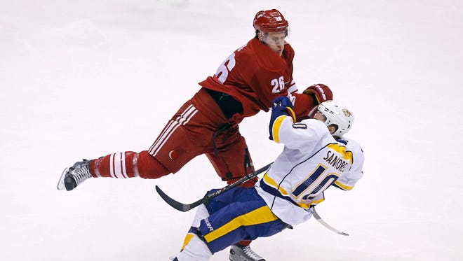 Arizona Coyotes defenseman Michael Stone (26) levels Nashville Predators center Mike Santorelli (10) during the first period of an NHL game on March 9, 2015 in Glendale.