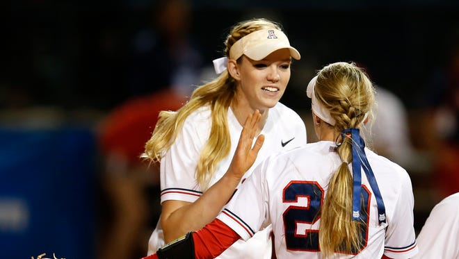 Arizona pitcher Michelle Floyd (94) celebrates with Kellie Fox (29) after Arizona defeated St. John's 4-2 during an NCAA college softball tournament regional game Friday, May 15, 2015, in Tucson, Ariz.