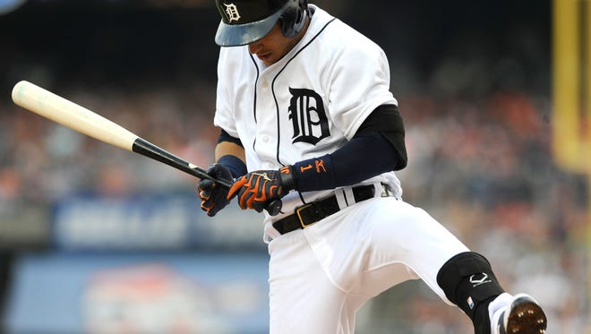 Tigers shortstop Jose Iglesias (1) reacts after getting hit by a pitch in the second inning.