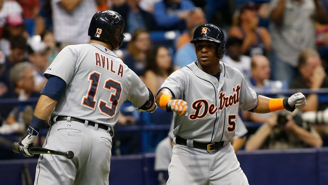 Yoenis Cespedes #52 of the Detroit Tigers celebrates with teammate Alex Avila #13 of the Detroit Tigers after scoring off of an RBI single by Nick Castellanos #9 during the seventh inning of a game on July 29, 2015 at Tropicana Field in St. Petersburg, Florida.