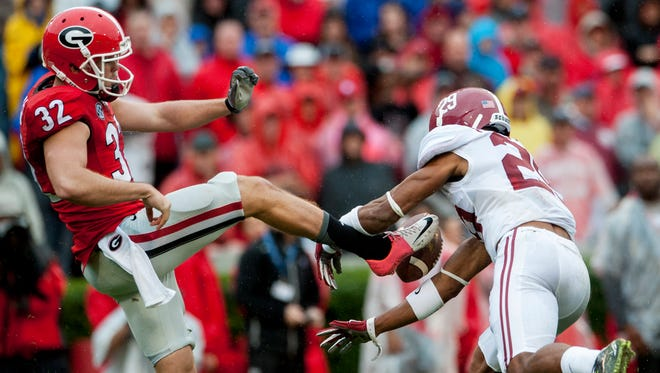 Alabama defensive back Minkah Fitzpatrick (29) blocks a punt by Georgia punter Collin Barber and runs it in for a touchdown at Sanford Stadium in Athens, Ga. on Saturday October 3, 2015. (Mickey Welsh / Montgomery Advertiser)