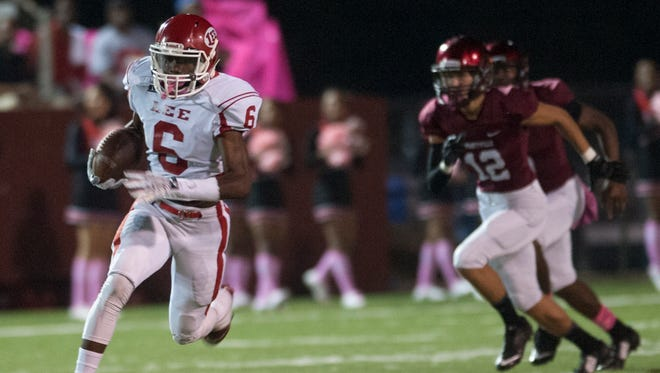 Lee's Henry Ruggs carries against Prattville at Stanley Jensen Stadium in Prattville, Ala. on Friday October 23, 2015.