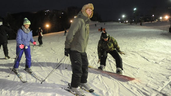 David Schuler and Piper Templeton of Asheville enjoy night skiing on the slopes of Cataloochee last year.