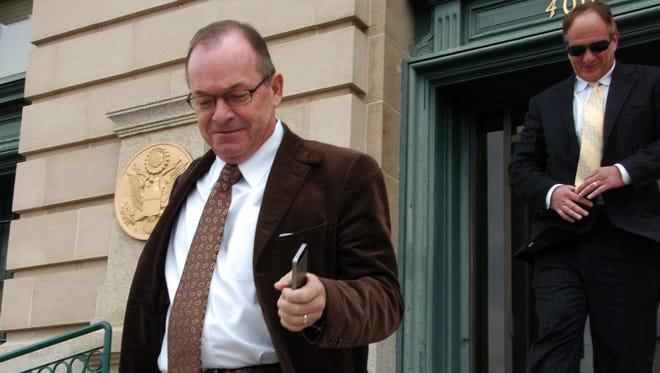 FILE - Embattled real estate mogul Tim Blixseth, left, leaves the U.S. Courthouse in Butte, Mont., on Monday, Nov. 3, 2014.
