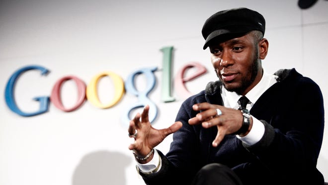 Musician Mos Def speaks on a panel discussing Google's new music search in Los Angeles on Oct. 28, 2009.