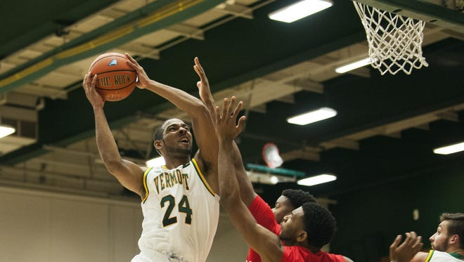 Catamounts guard Dre Wills (24) goes up for two during a men's basketball game between the Marist Red Foxes and the Vermont Catamounts at Patrick Gym earlier this season. Wills returns to the lineup Monday night after serving an eight-game suspension.