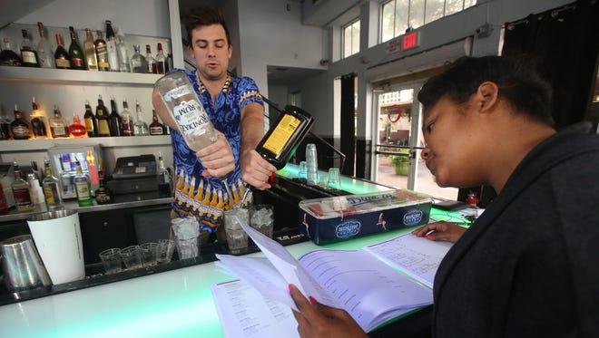Elite Bartending School students, Grayson Fernandez and Victoria Ho take a timed drink making challenge Jan. 21 during class. They had to make two Mai Tais, a vodka drink and four shots, all in two minutes. Fort Myers is Elite Bartending School's fourth location. It opened in October inside Celsius Night Club and Cowboy Up Saloon in downtown Fort Myers. It also focuses on job placement, workshops and event staffing.