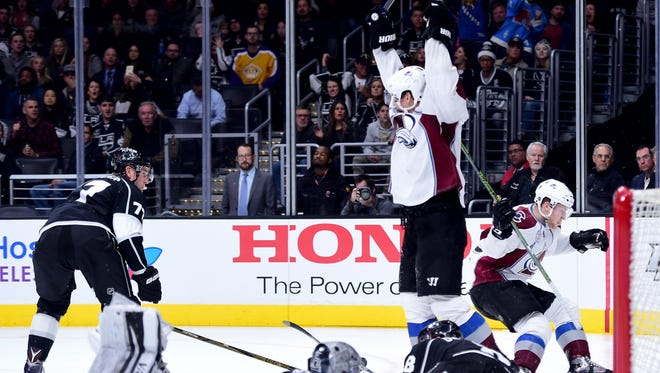 Nathan MacKinnon #29 of the Colorado Avalanche reacts to his goal to take a 4-3 lead over the Los Angeles Kings during the third period at Staples Center.