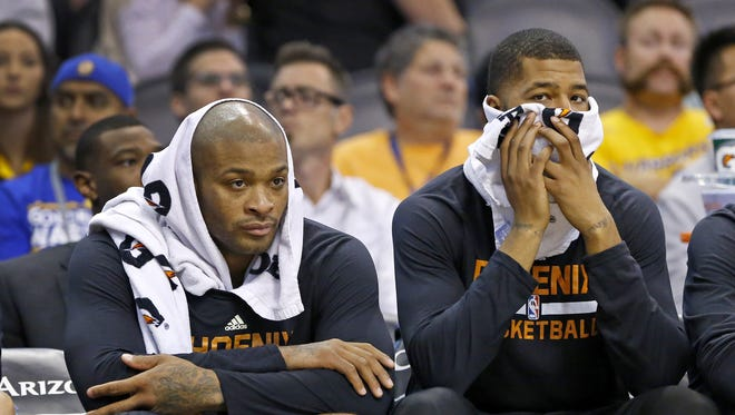 Phoenix Suns forward P.J. Tucker (17) and forward Markieff Morris (11) react late in their loss to the Golden State Warriors in  their NBA game Friday, Nov. 27, 2015 in Phoenix, Ariz.