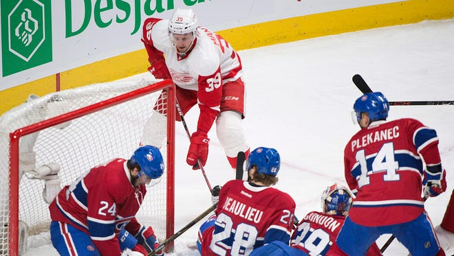 Detroit Red Wings' Anthony Mantha (39) scores against Montreal Canadiens goaltender Mike Condon as Canadiens' Phillip Danault (24), Nathan Beaulieu (28) and Tomas Plekanec (14) defend during the second period of an NHL hockey game, Tuesday, March 29, 2016 in Montreal. (Graham Hughes/The Canadian Press via AP) MANDATORY CREDIT