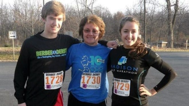 Maureen F. Mengelt of Sun Prairie, Wis., center, was killed April 7, 2013, when a vehicle driven by the Rev. Bruce H. Burnside struck her. Mengelt is shown in November 2012 with two of her children, Andrew and Megan Mengelt, at the Berbee Derby in Madison, Wis.
