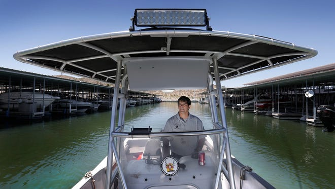 James Dominguez of New Mexico Game and Fish tours Elephant Butte as he collects water samples in search of invasive aquatic species like the Zebra Mussel. Dominguez says one of the most likely way invasive species can be introduced to the water if from water in boat hulls and pump systems, especially wake boarding boats with ballast tanks. New Mexico Game and Fish have begun boat inspections at New Mexico waters looking for boats which may contain on of the invasive species.
