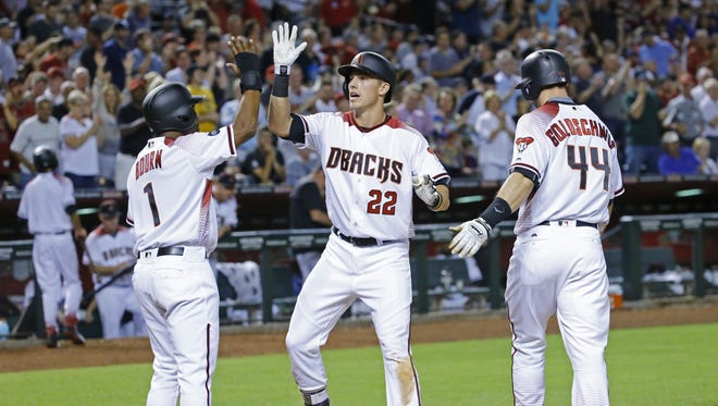 Arizona Diamondbacks' Michael Bourn (1) and Paul Goldschmidt (44) greet Jake Lamb (22) after his three run home-run against the New York Yankees in the 5th inning of their MLB game Monday, May 16, 2016 at Chase Field in Phoenix, Ariz.