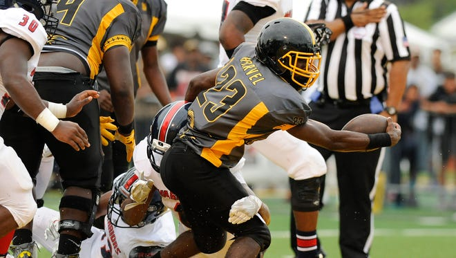 Kevin Willis scores one of his three rushing TD in Detroit King's win over Southfield A&T on Saturday at Wayne State. Willis finished with 161 yards rushing.