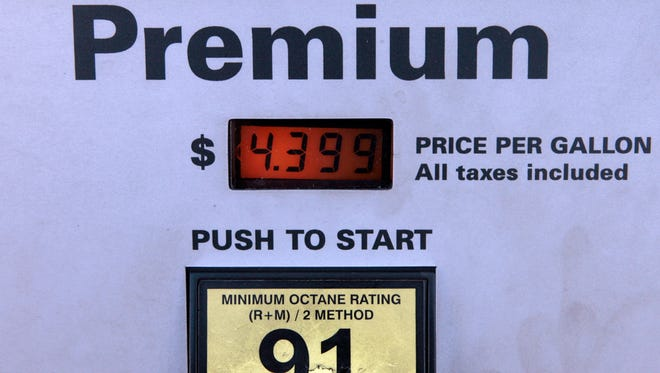 This Jan. 18, 2008, file photo shows the full service price per gallon of Premium gasoline  at a pump at a gas station in Berverly Hills, Calif.