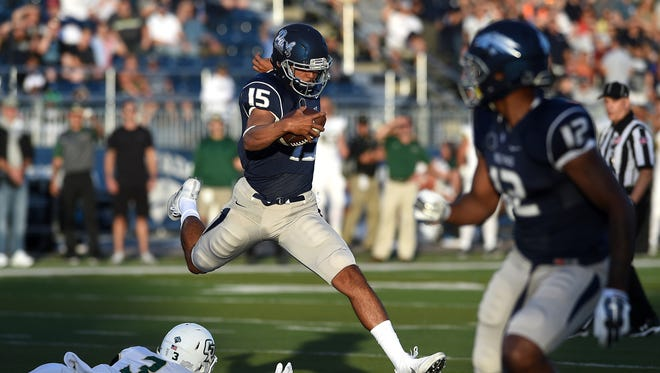 Nevada's Tyler Stewart runs away from a defender during the Wolf Pack's season opener against Cal Poly.