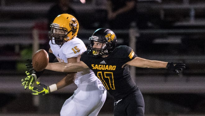 Saguaro's Michael Pickett (#17) is called for passing interference against Marcos de Niza's Christian Trevino (#15) during second quarter of their high school football game Thursday, Sept. 29, 2016 in Scottsdale, Ariz.
