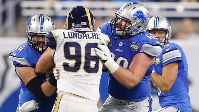 Graham Glasgow (60) of the Detroit Lions blocks Matt Longacre of the Los Angeles Rams during second half Oct. 16, 2016, in Detroit.
