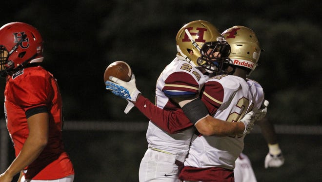 Hillsborough's Tyler Boatwright, right, and Ryan Melillo celebrate the first touchdown of the game after Boatwright recovered a blocked punt for the score in game at Hunterdon Central.