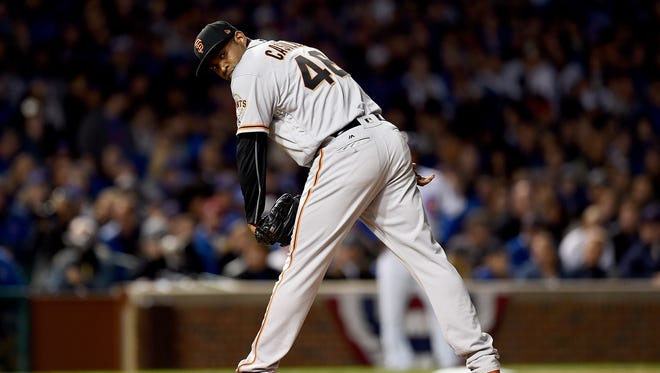 Santiago Casilla of the San Francisco Giants pitches against the Chicago Cubs on Oct. 8, 2016, in Chicago.