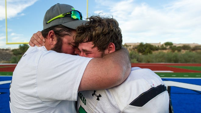 Thatcher's Zach Snodderley (#57) is congratulated by family after their Division 2A semifinal playoffs victory on Saturday, Nov. 19, 2016, at Fountain Hills High School in Fountain Hills, Ariz.