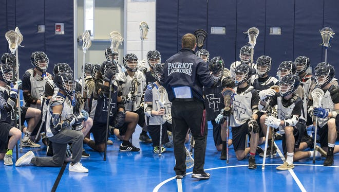 Freehold Township boys lacrosse coach Ryan Eichner speaks to the team before a preseason practice at Freehold Township High School on Tuesday, March 28, 2017