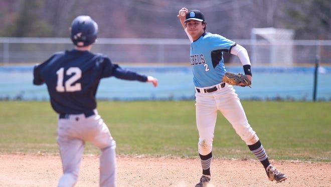 South Burlington shortstop Sam Premsagar turns a double play against Mount Mansfield during Saturday's baseball game in South Burlington.