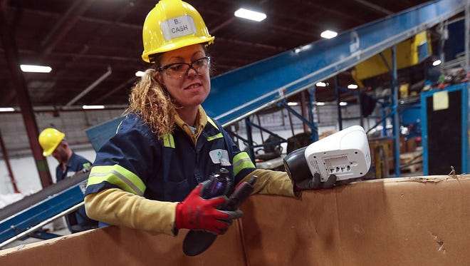 Brooke Cash, 36, of Anderson, Ind., shown Feb. 16, 2017, said her job at RecycleForce in Indianapolis 'saved her life' as she rebounds from convictions for theft and other crimes.