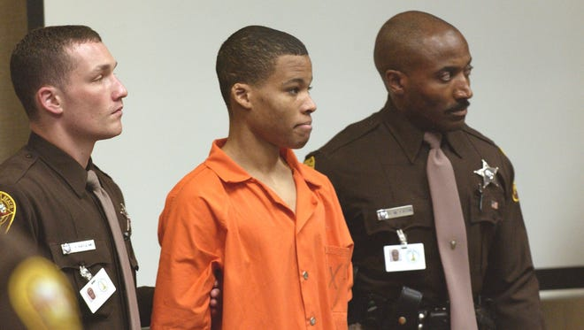 Sniper suspect Lee Boyd Malvo is escorted by deputies as he is brought into court to be identified  Oct. 22, 2003 in Virginia Beach, Va.