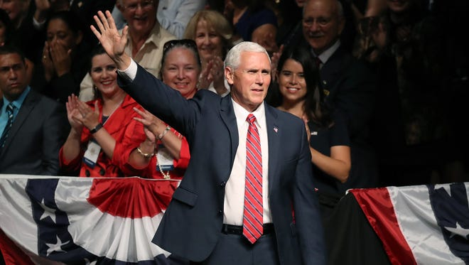 Vice President Mike Pence arrives to speak ahead of U.S. President Donald Trump announcing policy changes he is making toward Cuba at the Manuel Artime Theater in the Little Havana neighborhood on June 16, 2017 in Miami, Florida. The President will re-institute some of the restrictions on travel to Cuba and U.S. business dealings with entities tied to the Cuban military and intelligence services.