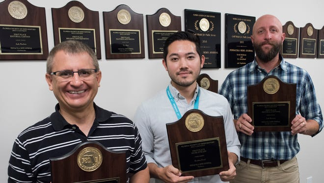 Pensacola News Journal Staffers, Gregg Pachkowski, Brandon Girod, and Andy Marlette received first place awards in the Florida Society of Newspaper Editors awards.
