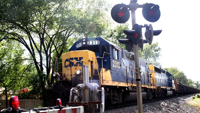A CSX train approaches an at-grade crossing April 23, 2012, in the Louisville suburb of St. Matthews, Ky.