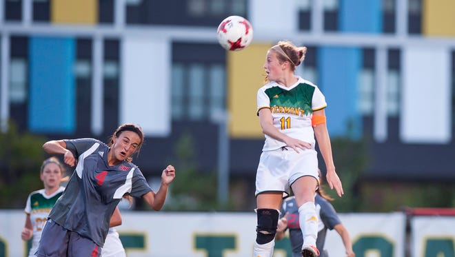 University of Vermont midfielder Brooke Jenkins, right, leaps for a header against Sacred Heart during Friday night's women's soccer game at Virtue Field.