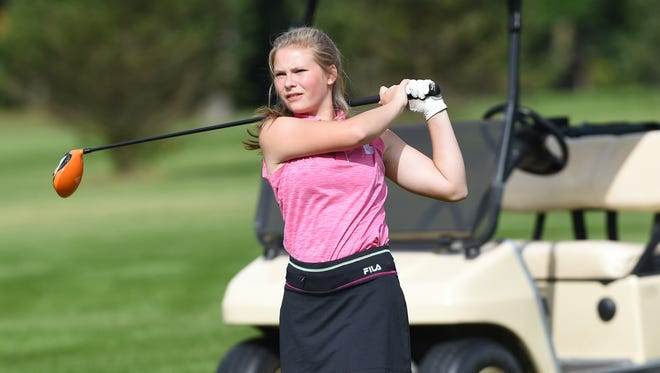 Ridgewood's Lexi ZImmer hits a tee shot during Monday's match against Indian Valley at River Greens.