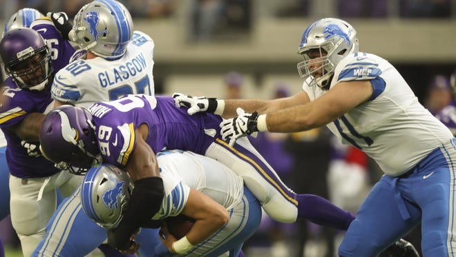 Lions offensive tackle Rick Wagner, right, can't prevent Vikings defensive end Danielle Hunter from sacking quarterback Matthew Stafford for a 5-yard loss on the first play of the game Oct. 1, 2017 at U.S. Bank Stadium in Minneapolis.