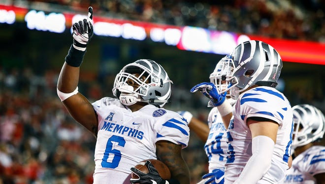 University of Memphis running back Patrick Taylor Jr. (left) celebrates  a touchdown against the University of Houston defense during third quarter action in Houston, Texas., Thursday, October 19, 2017.